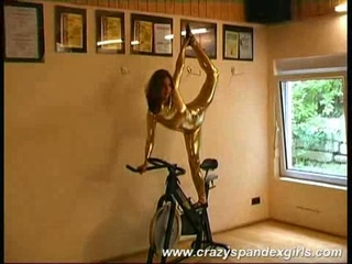 Acrobatic whore reveals jugs, stripping off her tight gold suit