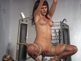 Hot brunette hair bounded and fucked by sybian