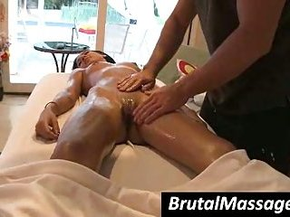 Amia Miley receives massaged with oil