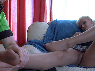 Seductive hottie encourages a stud to give her foot massage in advance of nylon sex
