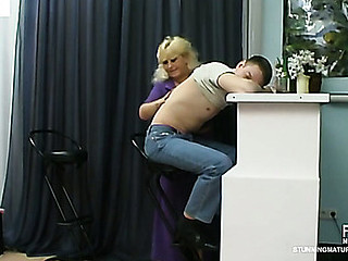 Lascivious older cookie treating sleepy guy like her sex toy for fucking