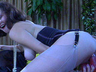 Wanton sweetheart undresses to her corset and nylons to test the massive sex toys