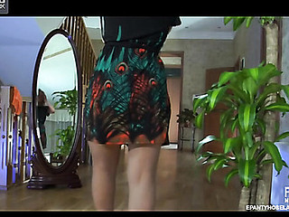 Flaxen-haired stunner spins by the mirror in her perfectly fitting sheer hose
