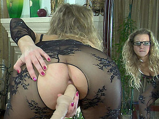 Angel in glasses stuffs her wet crack thru her lace pattern nylon bodystocking
