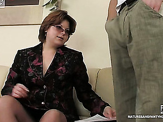 Inconsolable aged female co-worker in sheer tights having freaky fun in office