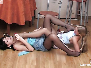 Remarkably pretty gals tongue-polishing nyloned feet to be passed on most wonderful advantage