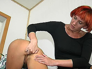 Redhead lesbo stunner fingering constricted butt previous to strap-on screwing on floor