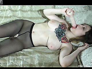 Tattooed hottie clad in crotchless barely black pantyhose fucking a rubber dong