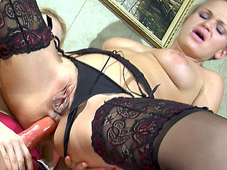 2 stocking-clad lesbian blondes tongue giving a kiss previous to coarse strap-on anal