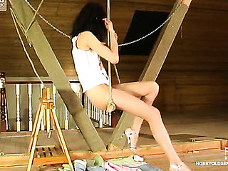 Frisky upskirt filly playing obscene games with older male right at the attic