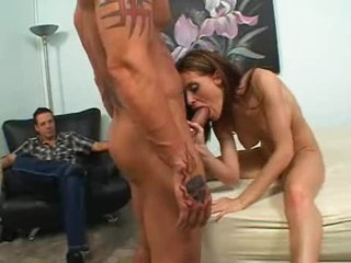 Milf Ginger Lea sucks a big cock while hubby watches her have fun.