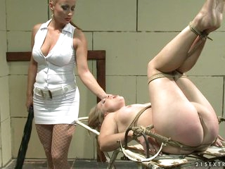 Katy Borman tied a hawt babe beyond an old metal table