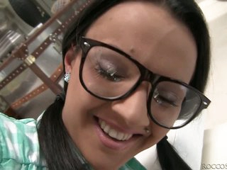 Youthful black haired hottie Tiana B with nice glasses feels horny. Round assed girl in green mini petticoat removes her yellow panties and gets her pussy touched from behind. Then she takes man meat in her hawt mouth form your POV and gets her nice big tits rubbed.