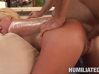 Youthful blonde receives mummified and screwed from behind