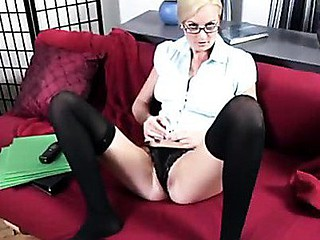 Elegant blond cougar uses a glass toy to satisfy her twat