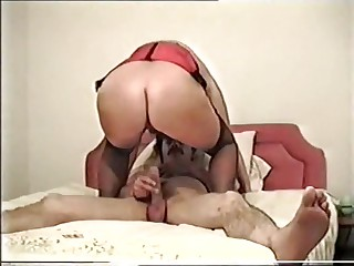 Mature chunky woman enjoys large cock.