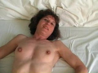 Mature in stockings plays with dick