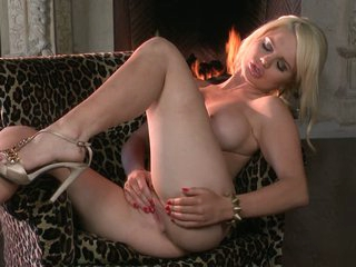 Breasty stunner Alexis Ford toys her bawdy cleft by the fireplace