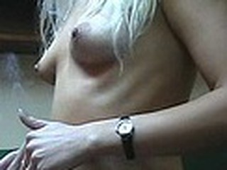 Lecherous blonde babe with small sticking tits walks naked in her room filmed by her boy-friend with amateur cam in his hands. He doesn't like her smoking but really enjoys her sexy nude body shyly covered by Fresh Year tree decoration :)