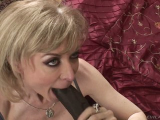 Nina Hartley is a admired looking