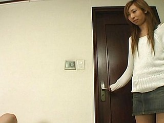 This asian playgirl in lacey white pants enjoys face fitting