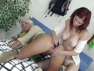 Lusty golden-haired and redhead lesbian lovers licking pussy and using toys