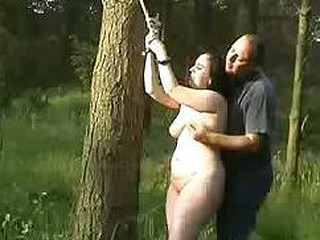 Chubby bitch gets tied up in the forrest