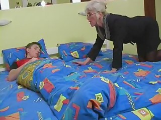 Mature here Silver Hair Glasses and Stockings Wakes the Boy