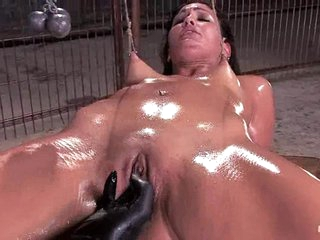 Tied slut gets fisted as her buddy caresses her clit with a vibrator