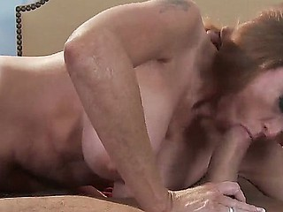 Danny Mountain is pleased to have sexy milf Darla Krane sucking his hard jock