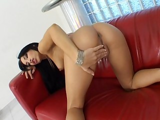 Mermerizing brunette goddess fingering her wet twat on the sofa