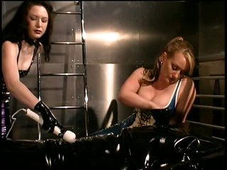 Cruel Dominatrices Torture a Submissive Male On a Bondage Sofa
