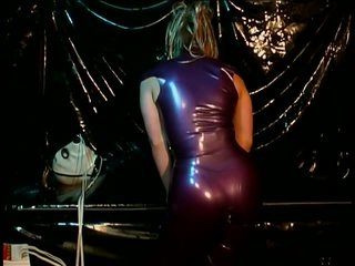 Latex Thrall Suspended From The Ceiling