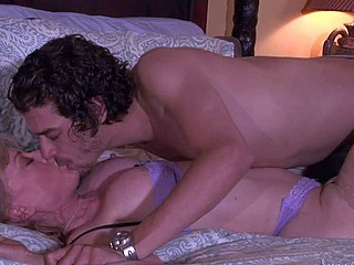 Nina Hartley is s consenting looking aged blonde with big