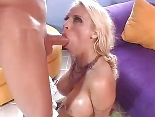Blonde pornstar with heavy knockers does blowjob on her knees