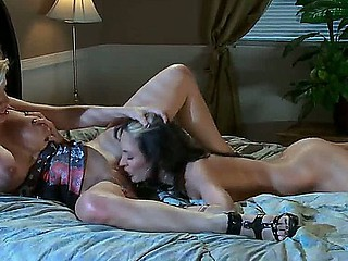 Ebony haired Alektra Blue and blonde