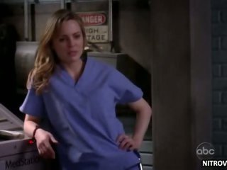 Sexy Golden-haired Melissa George Takes Off Her Nurse Robe