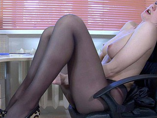 Hawt female co-worker in black stockings strokes her wet crack in every which way