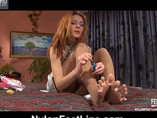 Vivacious chick frees her palatable toes from silky hose craving for pedicure