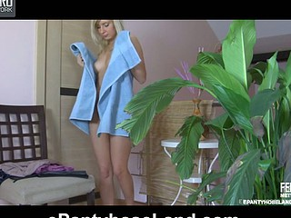 Just after a shower a sexy playgirl dresses up and puts on her grey pantyhose