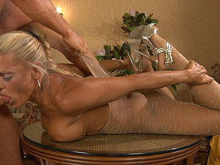 Muscled fellow in pantyhose mask licks and stuffs the nyloned box of his chick