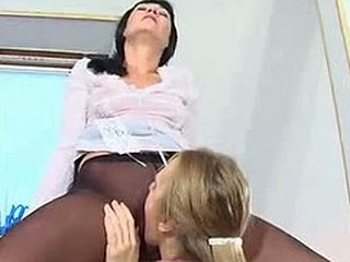 Female co-workers worshipping their pantyhosed moist cracks right in the office