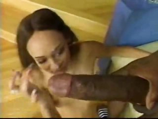 Skinny beauty sits on giant black dick
