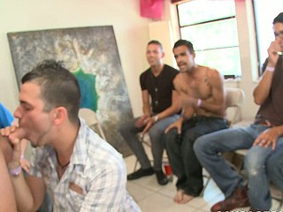 That stunning stud is playing with his cock and making blowjobs!