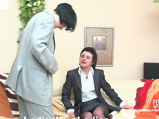 Two office honeys playing perverted lez games French giving a kiss and using strap-on