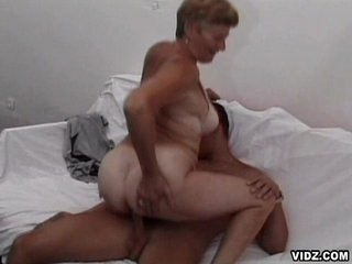 Wicked old granny enjoys enormous thick headed cock