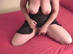 Busty mature with a very large clit is masturbating alone