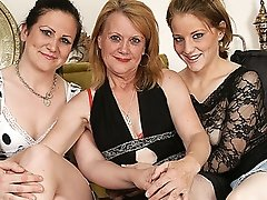 Three old and youthful lesbo babes go at it on the couch