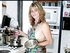 Gorgeous housewife widens her fur pie with a wooden spoon