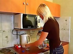 Blond chick is doing her businesses in the kitchen previous to getting holes nailed